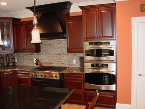 Custom built hood and kitchen cabinets.