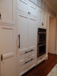 Custom built in refrigerator with white panels
