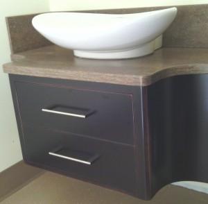 Custom built floating sink cabinet.