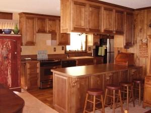 Custom built island and overhead cabinets.
