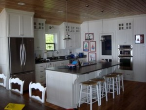 Custom built island with corbels and counter top over hang for seating.