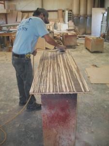 The sanding process of a custom built ADA flip down bar top.